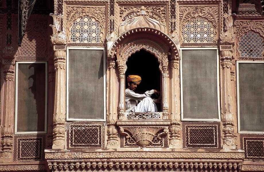 man in window jaisalmer