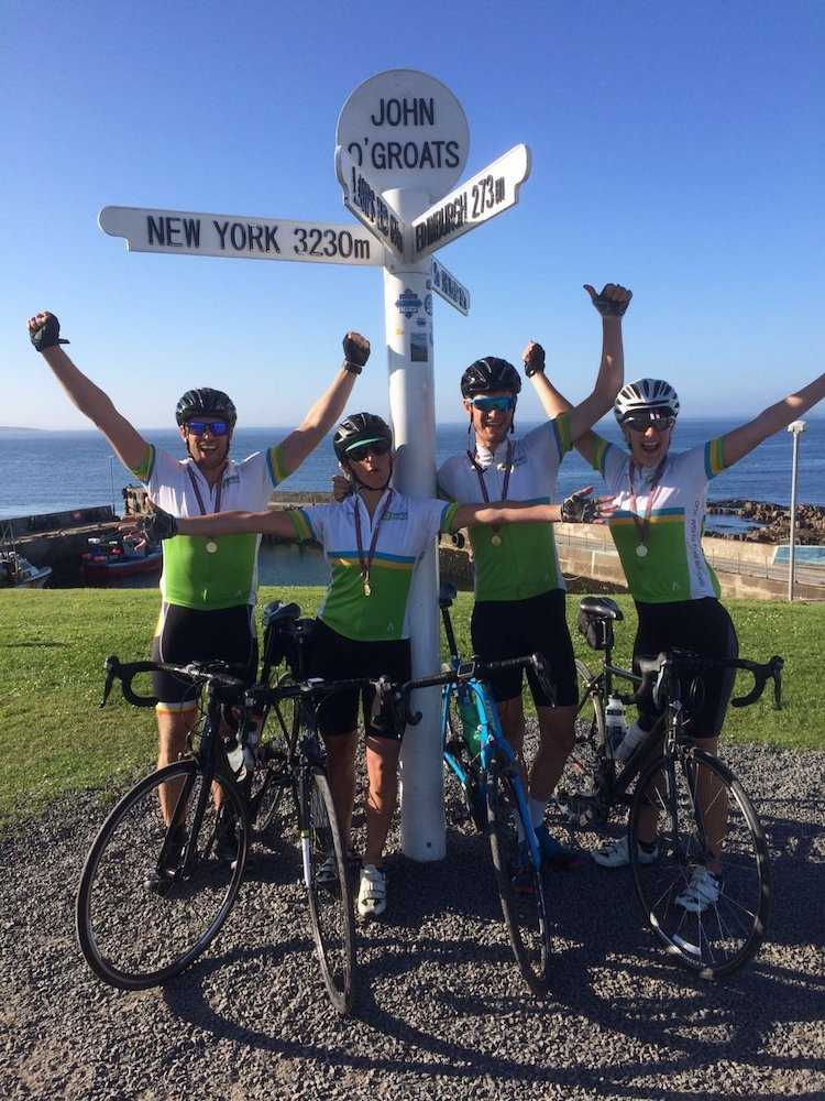 Our LEJOG team celebrating at their final destination - John O'Groats