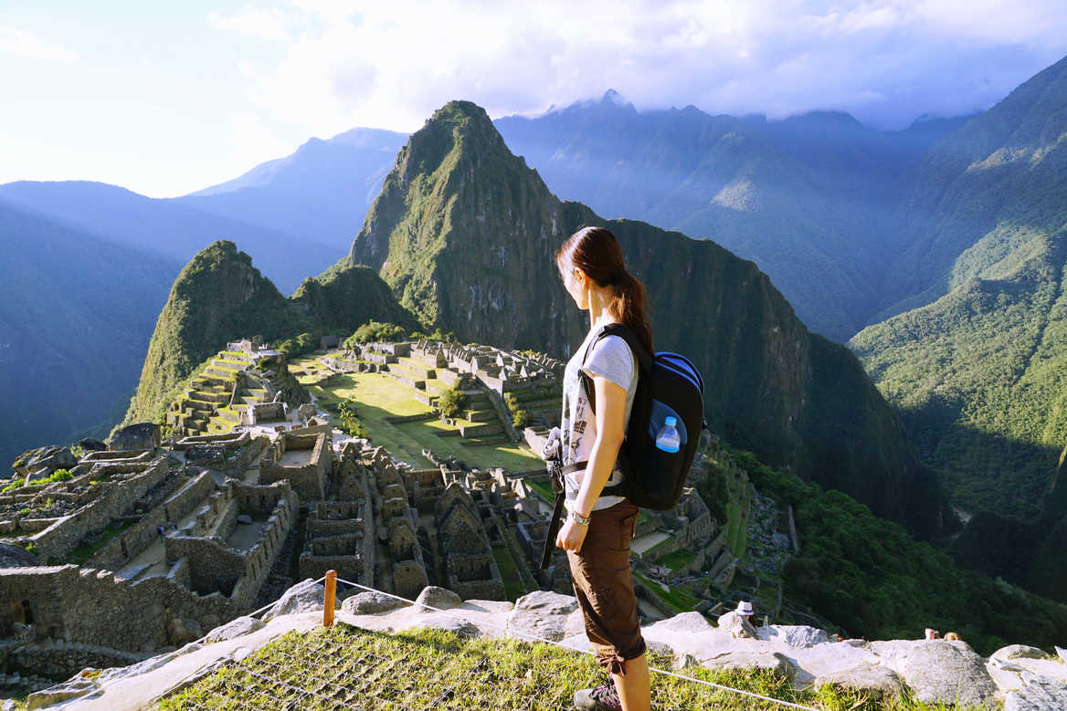 female traveller looking at Machu Picchu