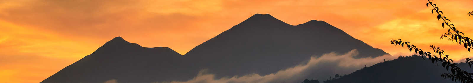 Fuego & Acatenango volcanoes at sunset, near Antigua, Guatemala