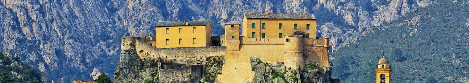 traditional villages with mountain backdrop