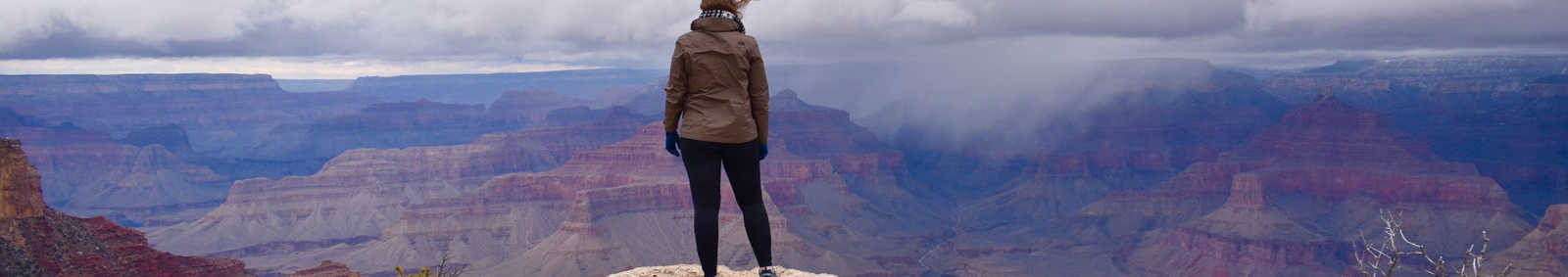 Woman looking over the Grand Canyon