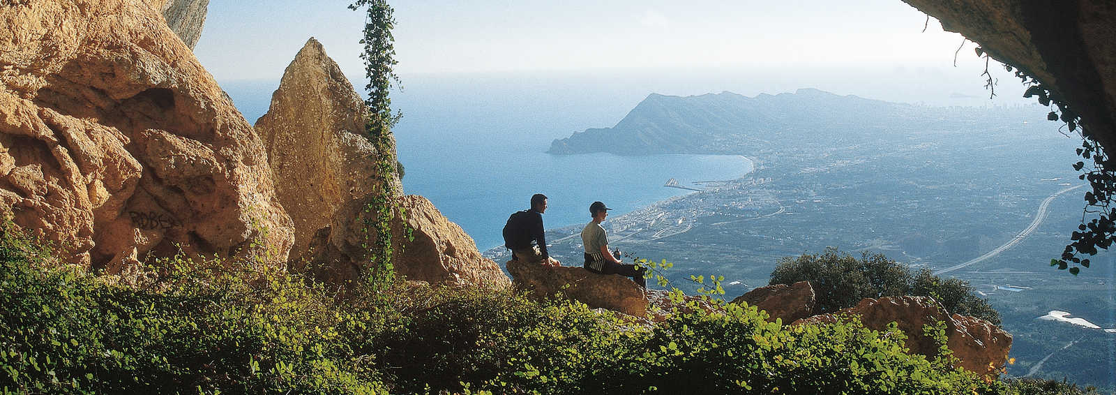Walkers admire vista, Spain
