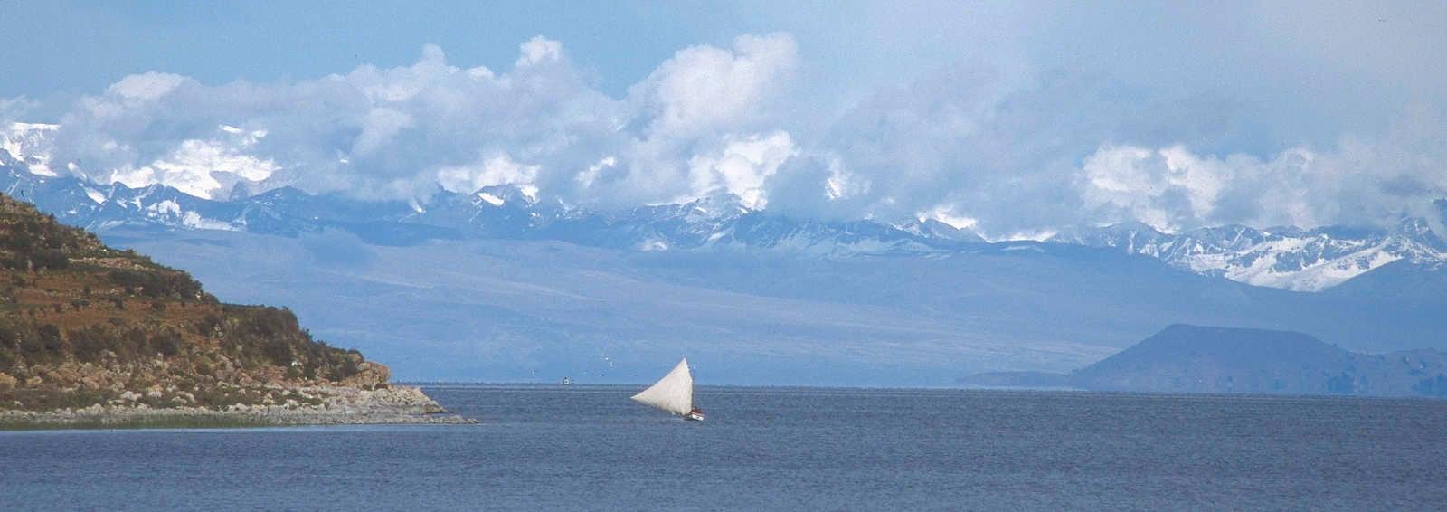 Sailboat by Island of Sun, Lake Titicaca. Cordillera Real behind.