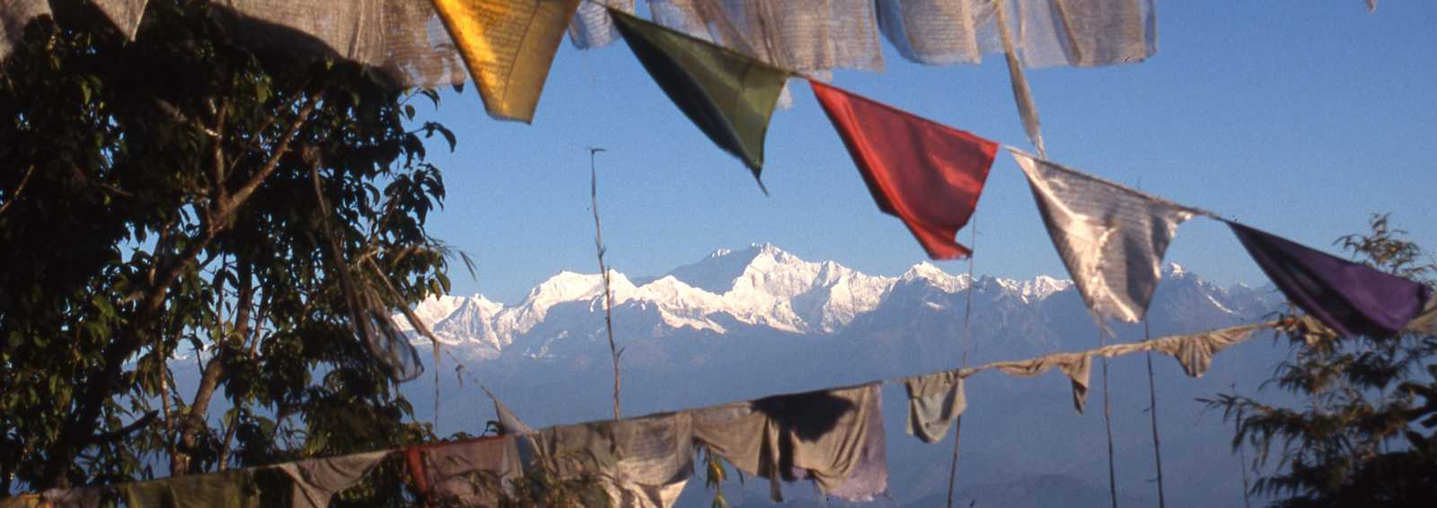 Kanchenjunga and prayer flags from Darjeeling, India