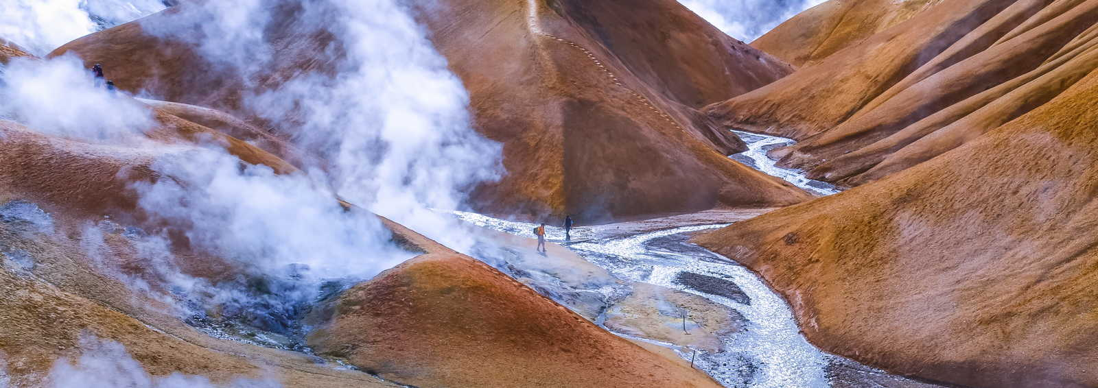Geothermal smoking field with people, Kerlingafjoll, Iceland