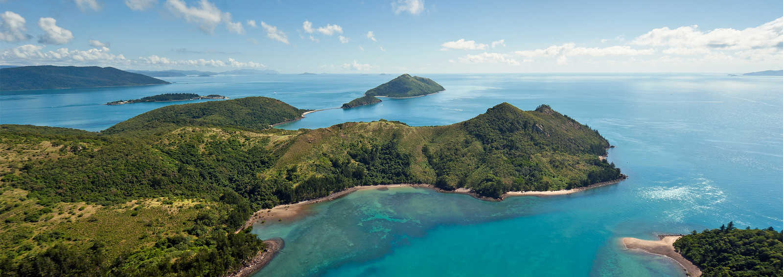 Dramatic Helicopter view of the Whitsunday Islands and surrounding seas in Queensland, Australia