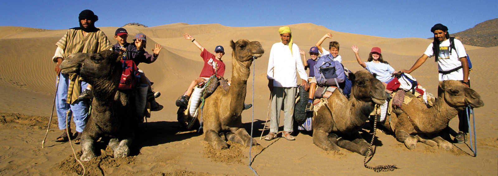 Family adventurers with their camels and drivers