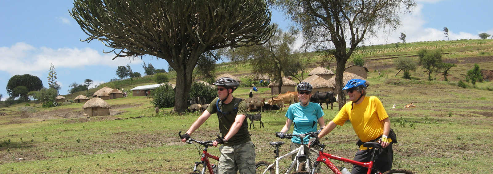 Cyclists and local settlement near Arusha