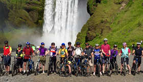Exodus group in front of Skogafoss waterfall, Iceland