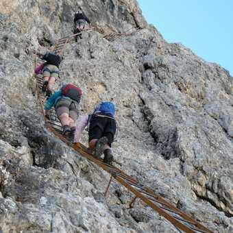 Climbing ladders on the Merlone via ferrata route