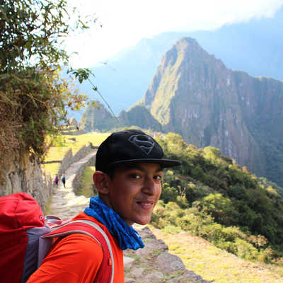 Boy arriving at Machu Picchu, Peru