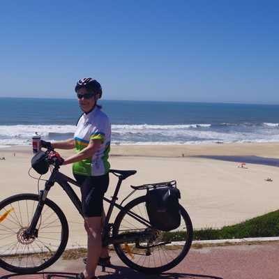 Cyclist by Nazare beach