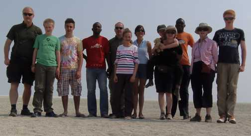 Group posing at Etosha salt pan